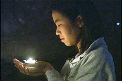 Ms. Yeong-ching Foo, 29, prepares candles before a recent appeal in Washington DC. Her fiancé, Dr. Charles Li, is now on hunger strike in a Chinese prison to peacefully protest his illegal imprisonment and severe human rights violations against Falun Gong practitioners.