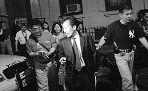Mr. Guan Jun Liang, a Pro-Communist leader and chairman of the Unified Organization of Overseas Chinese Associations, was arrested by New York City police for his leading role in a group assault against Falun Gong practitioners near a local restaurant. (news)