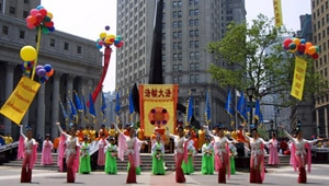 "Falun Gong practitioners in New York City perform the dance ""Heavenly Spectacle,"" depicting a scene from an ancient Chinese legend, which says that tens of thousands of years ago, Buddha saw the danger mankind's moral decay would bring to living beings and decided to go down to the human world. The legend says the Celestial Kingdom was then filled with music and dance."