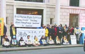 Falun Gong practitioners appeal in front of the Chinese Embassy in London, calling for Jiang, Luo, Zhou and Liu to be brought to justice.