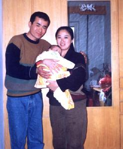 Wang Yunjie with her husband and child before she was abducted by Chinese police.