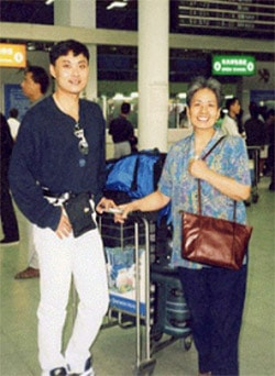 Zhendong and his mother, Yueli Yang, who was an aeronautics scientist in China's space program. Ms. Yang was illegally imprisoned for over a year because she practices Falun Gong.