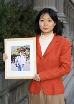 New Yorker Christina Yuan holding a photo of her mother who has suffered extreme torture in a Chinese labor camp for her practice of Falun Gong.