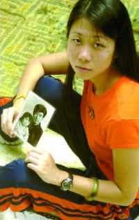 Danielle Wang, 22, holding a photo of her father who is now imprisoned in China for practicing Falun Gong.
