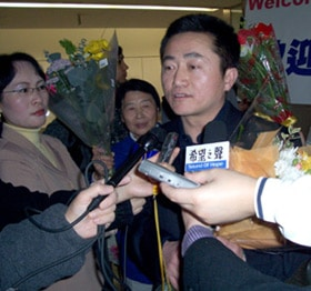 Dr. Charles Lee, an American citizen, takes questions from reporters upon returning to California after three years of illegal imprisonment and torture in China.