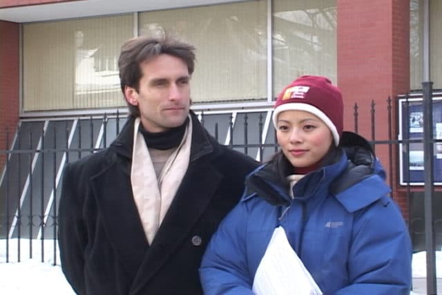 Joel and Cecilia stand outside the Chinese embassy in Toronto, Canada