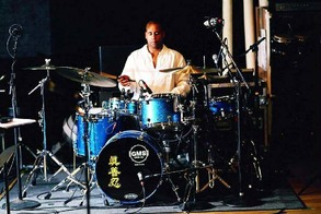 "With the Chinese characters ""Truth, Compassion, and Tolerance"" emblazoned on his drum kit, Sterling Campbell uses his music as a platform for human rights in China"