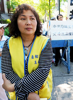 Judy Chen says she was punched last week as she tried to hand out literature in support of Falun Gong