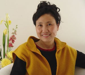 Ms. Wang Weixing, shown here in a 2007 photo, is a painter who graduated from San Francisco's Academy of Art University and now lives in Queens. Ms. Wang was physically assaulted in Flushing, New York by a member of a pro-Beijing mob.