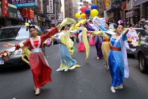 Dance of the Heavenly beauties. A Falun Gong Parade in Manhattan's China town.