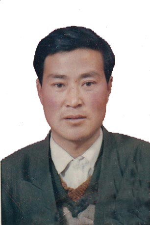 Mr. Fan Zhenguo prior to his most recent abduction. Prison authorities notified his wife via text message that he died on September 11, 2011