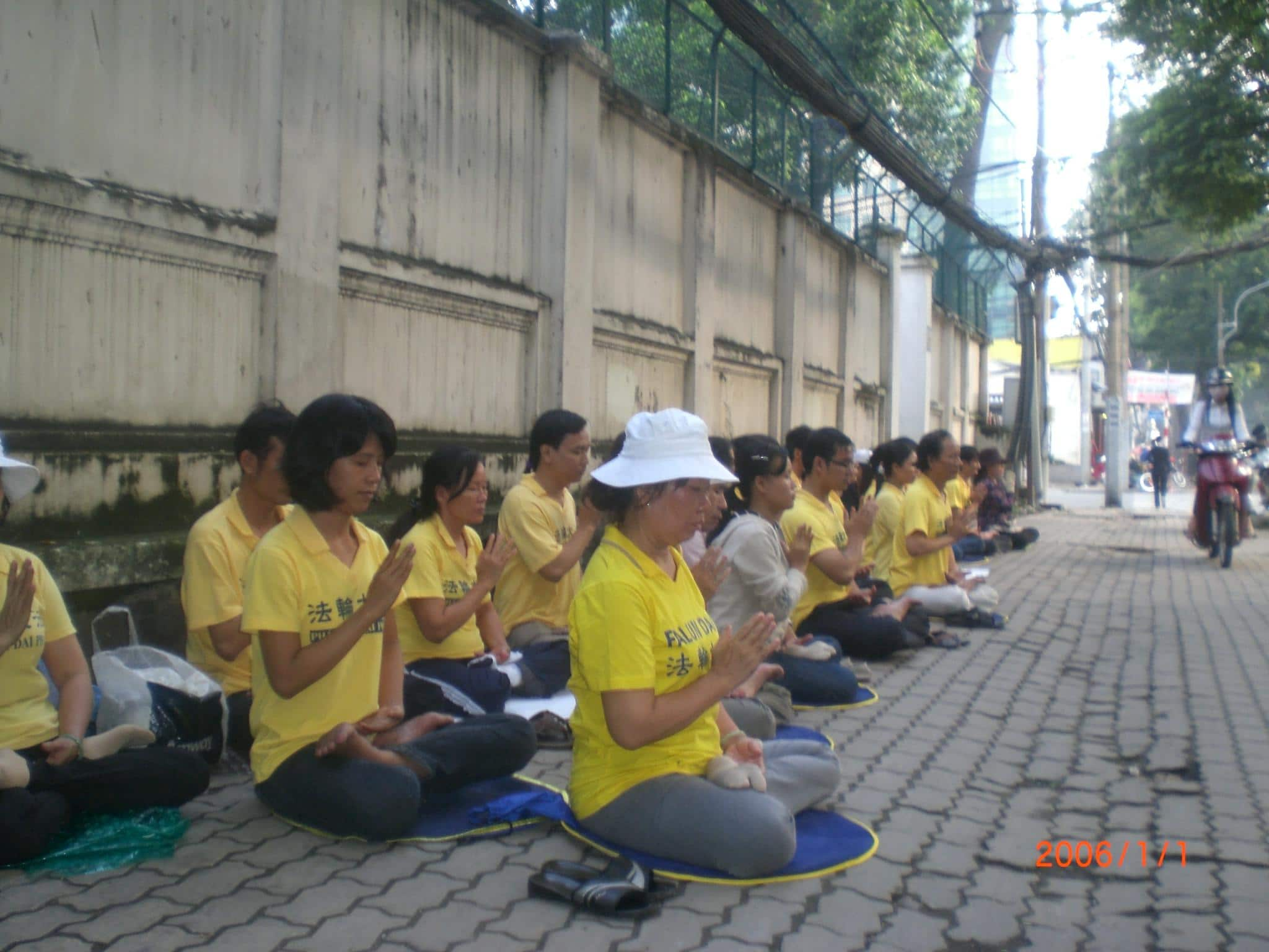 Falun Gong practitioners holding a sit-in in front of the Chinese consulate in Hanoi on October 6. Soon after this photo was taken, Vietnamese authorities forcibly detained over 30 of the participants.