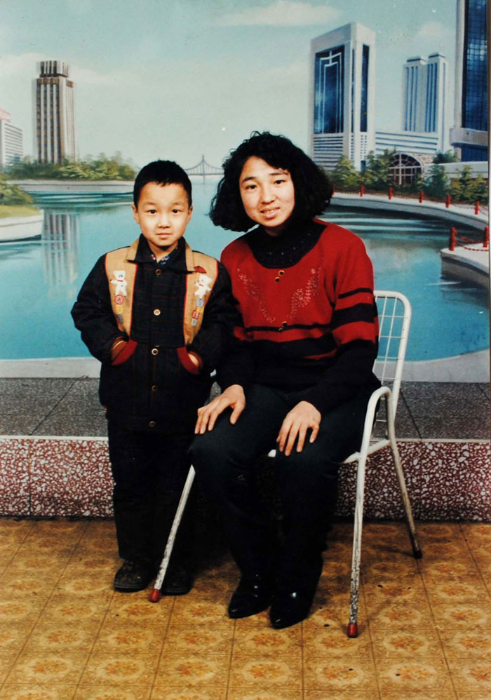 A photo of Ms. Yuan Pingjun with her son several years prior to her arrest. Ms. Yuan was abducted by Chinese security agents on August 2, 2010 taken to a brainwashing center. Nine days later her family was notified that she had died