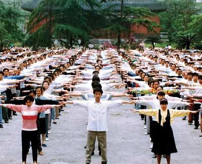 A MORNING STRETCH: Residents of Sichuan province perform the first exercise of Falun Gong. Millions in China discovered the powerful health benefits of the practice in the 1990s.