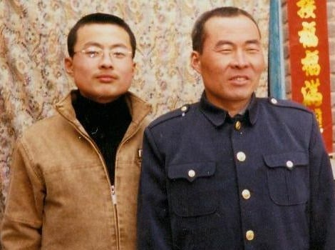 Mr. Li Lankui and his son. Li was abducted by police in Hebei province in June ahead of a visit to the region by Iowa governor Terry Branstad
