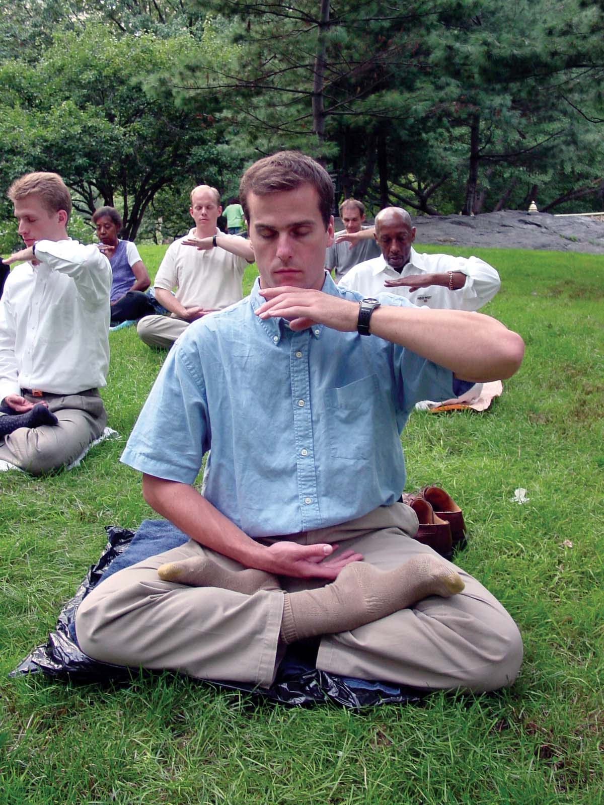 An American student of Falun Gong performs the practice's meditation,  tapping into a many centuries old Chinese tradition.
