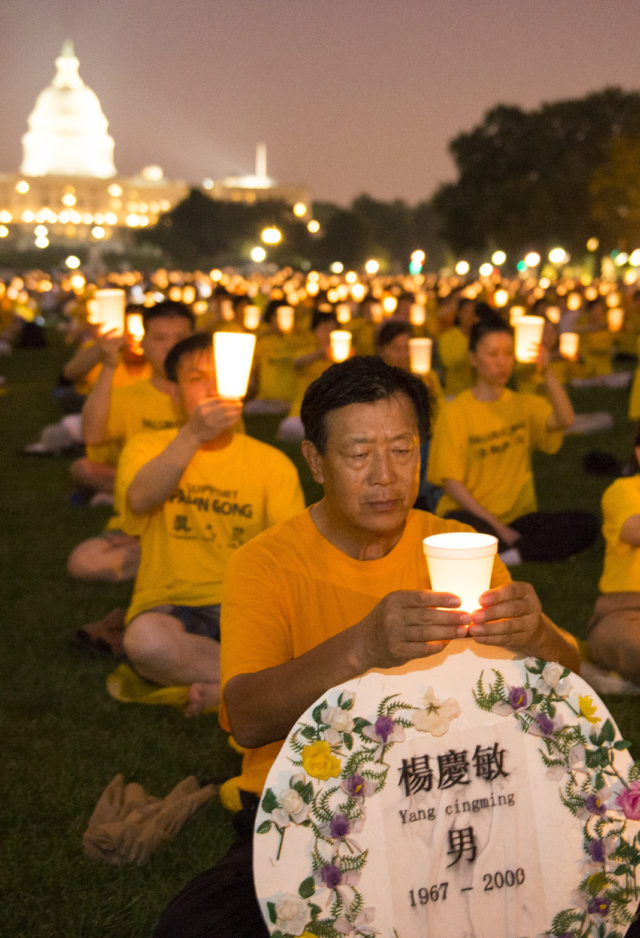 Falun Gong practitioners and supporters hold a candle-light vigil in Washington DC for those killed in China.