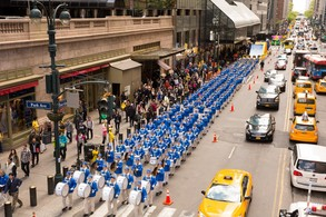 The Divine Land Marching Band marches in a parade along 42nd Street in New York for World Falun Dafa Day on May 12, 2017. (Evan Ning/The Epoch Times)