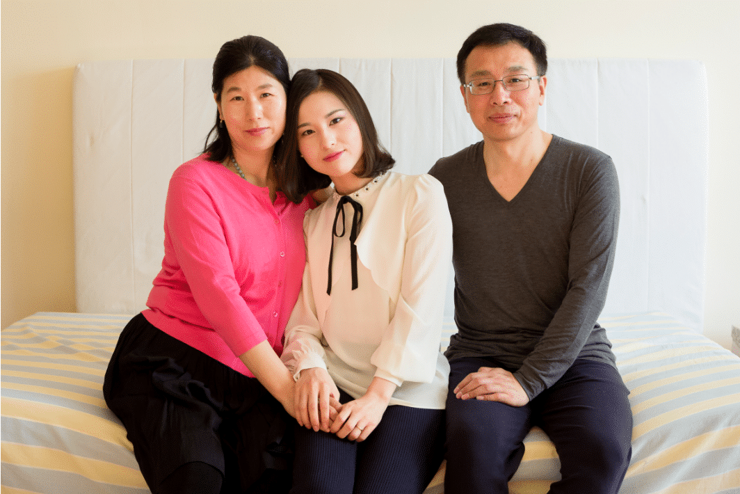 (L–R) Wang Huijuan, Li Fuyao, and Li Zhenjun at their home in Queens, New York, on Jan. 8, 2017. The family escaped China in 2014 and were granted asylum after enduring years of separation and torture for practicing Falun Gong. (Samira Bouaou/Epoch Times)