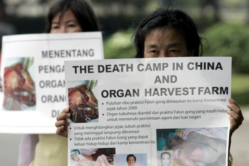 Falun Gong followers protest China's practice of harvesting organs from prisoners. Beawiharta/REUTERS
