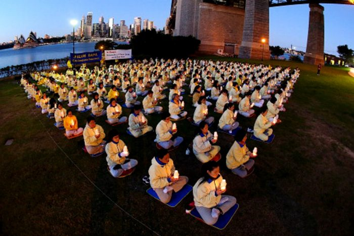 Falun Gong practitioners hold a candlelight vigil in Sydney July, 2013 to mark the 14th anniversary of the beginning of the Falun Gong persecution. Getty Images