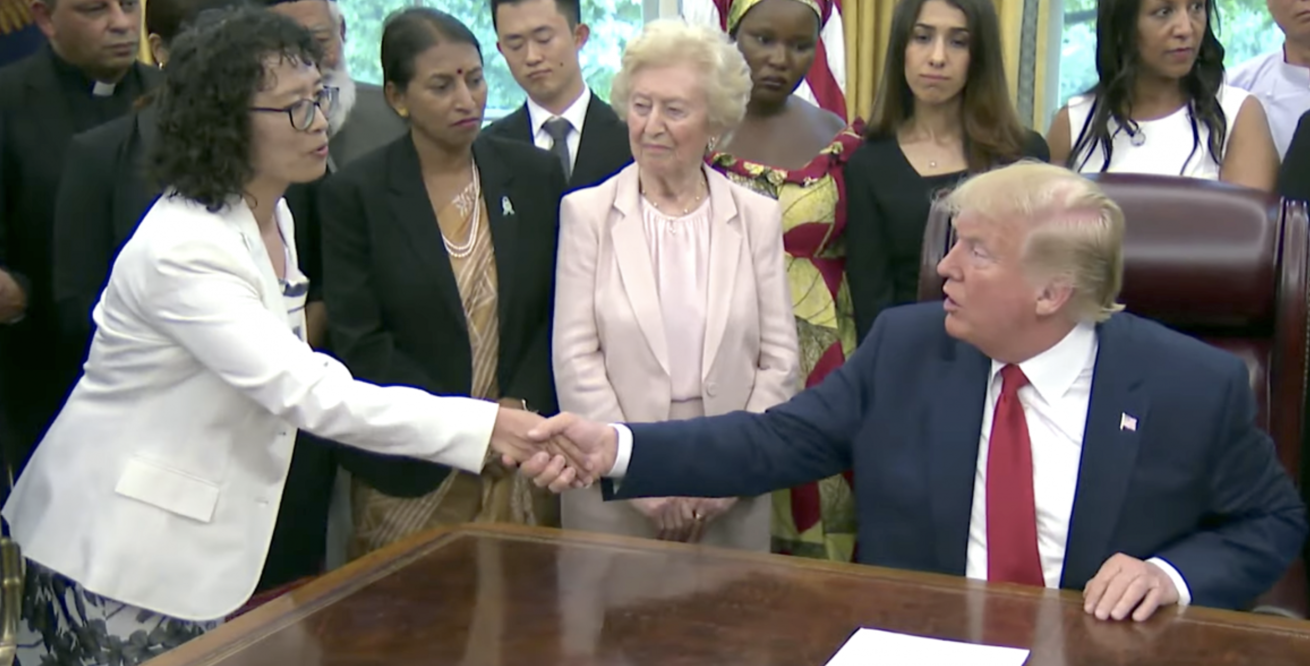 U.S. President Donald Trump shakes hands with Ms. Zhang Yuhua, a Falun Gong practitioner who survived persecution in China, at the White House on July 17, 2019. (Screenshot/The White House)