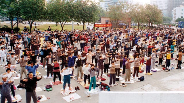 Morning Falun Gong exercises in Beijing park, 1998.