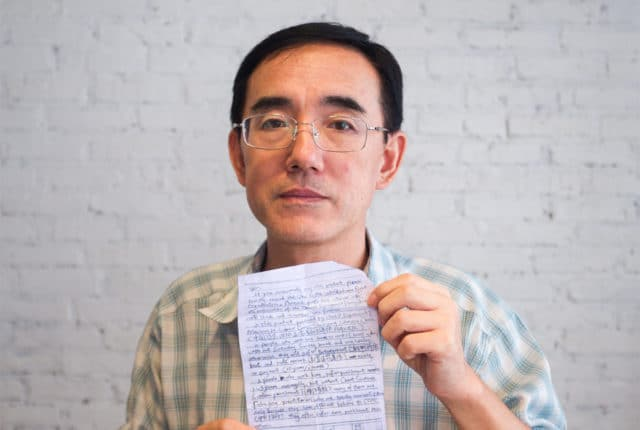 LETTER FROM A CHINESE JAIL Mr. Sun Yi holding the SOS letter he wrote, that made its way around the world and back to him.