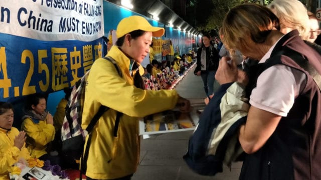 During a peaceful protest in Australia, Angel tells passers-by about the persecution of Falun Gong in China.