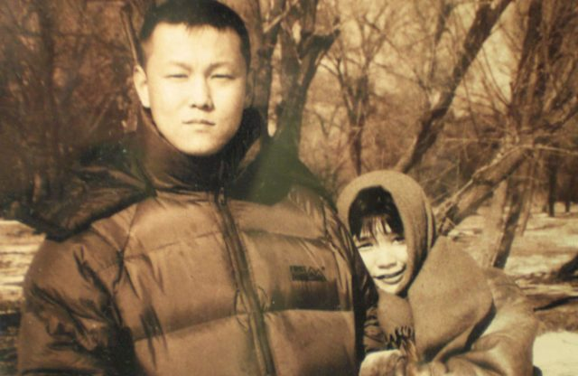 Ms. Xu Na (above, right) pictured with her late husband, Mr. Yu Zhou (above, left). Yu was arrested in Beijing shortly before the 2008 Beijing Olympics and died in police custody several days later. Xu was imprisoned and tortured for several years following her husband's death.